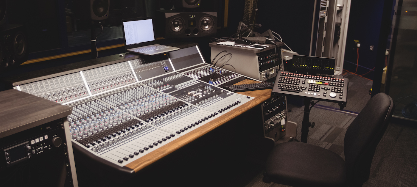 Sound Mixer In A Studio With Laptop